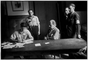 FRANCE. Paris. Town hall of the 7th arrondissement. August 1944. Sacha GUITRY, French actor and playwright, is interrogated about his relations with the Germans.