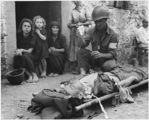 private_roy_w-_humphrey_of_toledo_ohio_is_being_given_blood_plasma_after_he_was_wounded_by_shrapnel_in_sicily_on_8-9-43_-_nara_-_197268