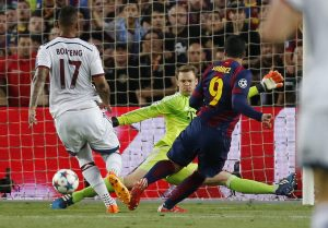 Bayern Munich's Manuel Neuer saves from Barcelona's Luis Suarez